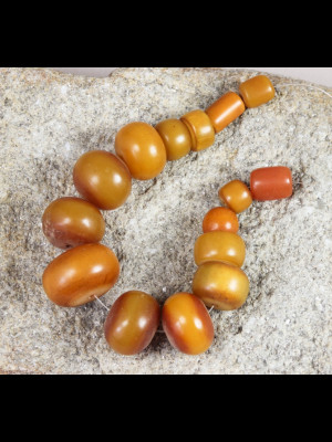 11 African amber beads (phenolic resin)