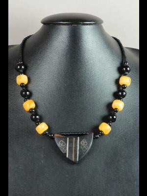 Necklace with wood pendant, glass beads and beads imitating amber