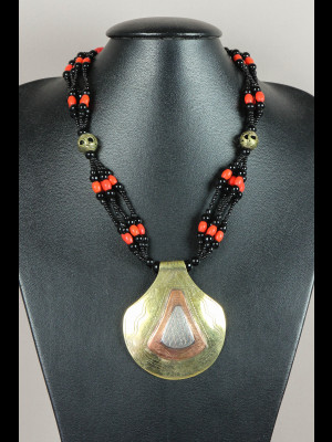 Necklace with glass and brass beads and a brass pendant with copper and silvered metal