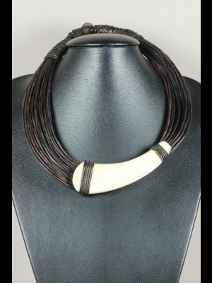 Necklace with leather threads and a warthog tusk