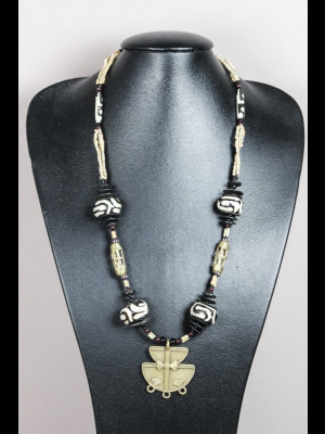 Necklace with bone beads, brass beads, terracoota beads, bakelite heishi disk beads and brass pendant