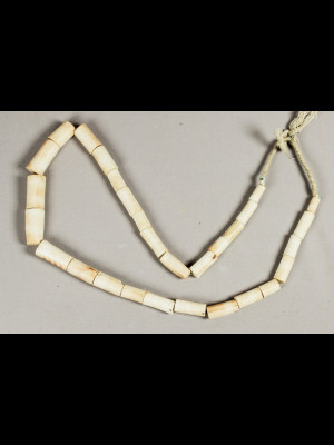 15 old beads in white coral