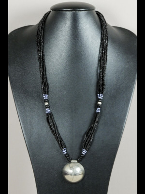 Necklace with glass beads and a silvered metal pendant