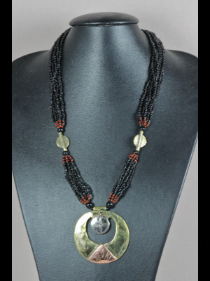 Necklace with brass and glass beads, medallion of brass and silvered metal